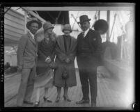 Race car drivers, Earl Cooper and Barney Oldfield with their wives on deck of ship, circa 1926