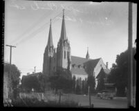 Exterior view of a Episcopal Church and street at Hoover and Adams Street in Los Angeles, Calif. circa 1923