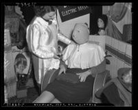 Los Angeles Coiffure Guild woman wearing electric face mask, circa 1939