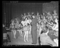 Earl Carroll and his dancing girls at California Amusement Machine Operators Association Party in Los Angeles, Calif., 1939