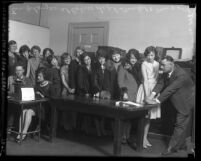 Women clerical employees of Los Angeles Police Department getting fingerprinted and photographed in 1928