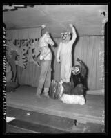 """Three performers in animal suits for """"The Last War"""" play at First Congregational Church of Los Angeles, Calif."""