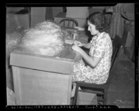 Woman packaging tinsel at National Tinsel Manufacturing Company's Los Angeles warehouse in 1939