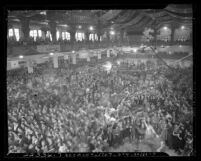 Overhead view of crowded auditorium during Jitterbug Dance contest Los Angeles, Calif., 1939