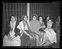 Six Gypsy women sitting in jail cell in Los Angeles, Calif., 1940