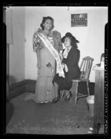 Miss Philippine Commonwealth of 1939 Gloria Talaugon with Guadalupe Palomo Malasig of Los Angeles, 1940