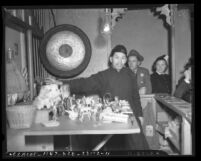 Charlie Chan, fortune teller, in Chinatown, Los Angeles, circa 1940