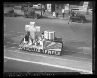 Angelus Temple parade float with Four Square Gospel insignia and a huge Bible, Los Angeles, 1935