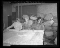 Two women in masks making mattresses as another looks on in California State Emergency Relief Administration program, 1935