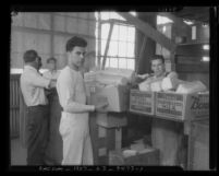 Six men sorting boxes at Los Angeles County Welfare Food Exchange, circa 1934