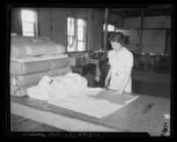 Woman cutting clothing patterns at a California State Emergency Relief Administration program, 1934