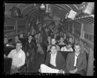 Interior of train car loaded with Citizens' Military Training Camps members leaving for summer camp, circa 1940