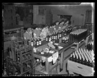 Women workers packaging scotch whiskey at the Bohemian Distributing Co. Los Angeles, Calif., circa 1940