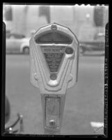 Close up of parking meter in Long Beach, Calif., circa 1940