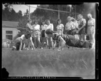 Women applicants for the Los Angeles Police Department during their physical fitness test, circa 1940