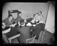 Congressman Martin Dies with reporters during break in Los Angeles hearing of House Committee on Un-American Activities, 1940