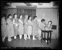 Women prison inmates registering to vote in Los Angeles, Calif., 1940