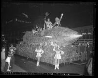Pre-Christmas parade in downtown; features rocket ship float with Santa Claus in Los Angeles, 1940