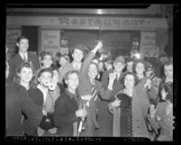 People on Broadway Street celebrating New Year's Eve, 1940 Los Angeles, Calif.
