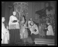 John Joseph Cantwell seated on throne with scepter at his elevation to archbishop ceremony in Los Angeles, Calif., 1936