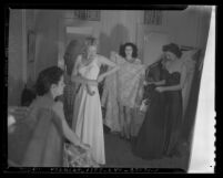 Four models dressing for Los Angeles, Calif.'s 1941 Spring Fashion show