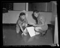 Two Boy Scouts, Joe Takahashi and Toshio Mashimoto working on task in Los Angeles, Calif., circa 1941
