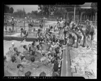 Group of boys at a pool for the 1941 Los Angeles Daily News swimming contest