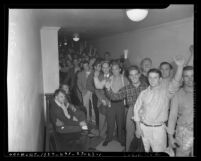 Line of men signing up for the U.S. Navy following the 1941 attack on Pearl Harbor, Los Angeles, Calif.