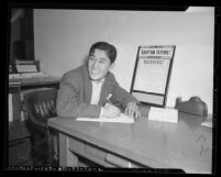 Japanese American Richard Sugimoto enlisting in the U.S. Army following the 1941 attack on Pearl Harbor, Los Angeles, Calif.