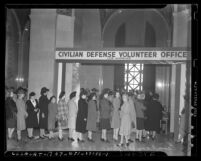 Women lined up at Civilian Defense Volunteer Office at Los Angeles City Hall following 1941 attack on Pearl Harbor
