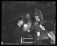 T. K. Chang, Chinese Consul to Los Angeles, Calif., greeting delegate Li Yu Ying upon his arrival to the United States in 1941