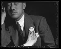 "Korean American man wearing button stating ""Korea for victory with U.S."" in 1941, Los Angeles, Calif."