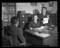 Three members of Caballeros de Dimas-Alang working in office during 1942 conference in Los Angeles, Calif.