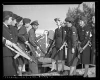 Eight women of Bundles for Bluejackets being instructed on using rifles by a Los Angeles County sheriff, circa 1942