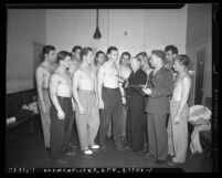 Group of ten shirtless men undergoing medical examinations during enlistment for U.S. Marines in Los Angeles, Calif. in 1942