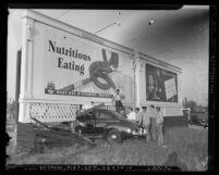 Automobile crash into billboard on Wilshire Blvd. and Mansfield Street in Los Angeles, circa 1942