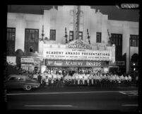 Crowd lining street under the marquee of the Pantages Theater at the 31st Academy Awards in 1959