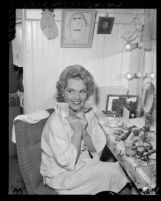 Actress Judy Holliday clutching telegram in her dressing room before opening of the 22nd season of the Los Angeles Civic Light Opera