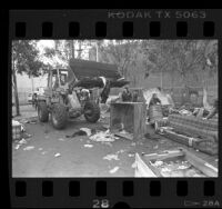 Bulldozer clearing homeless camp in Los Angeles, Calif., 1987