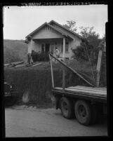 Workmen preparing house to be moved out of Chavez Ravine in Los Angeles, Calif.