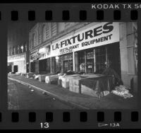 Homeless sleeping in boxes along storefronts in Los Angeles, Calif., 1987