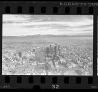 Aerial cityscape of mountains and downtown, Los Angeles, 1987