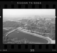 Aerial view of Elysian Park, Silver Lake Reservoir and Dodger Stadium in Los Angeles, 1987