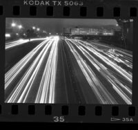 Night photograph, streams of automobile lights on Harbor Freeway, Los Angeles, 1987