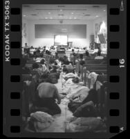 Inmates bedding down and watching television in chapel of Central Jail in Los Angeles, Calif., 1987