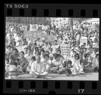 Crowd with signs in Korean and English at rally in support of protesters in South Korea, Los Angeles, 1987