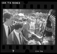 Spain's King Juan Carlos I and Queen Sofia meeting Aztec dancers in Los Angeles, Calif., 1987