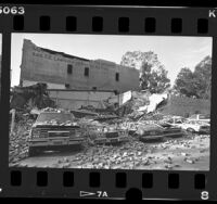 Earthquake damage automobiles and collapsed building at 100 block of S. Fair Oaks in Pasadena, Calif., 1987
