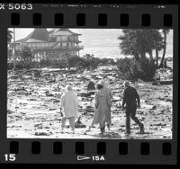 People walking amid storm debris in Redondo Beach, Calif., 1987