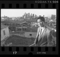 Haing S. Ngor on balcony overlooking downtown Los Angeles, Calif., 1988